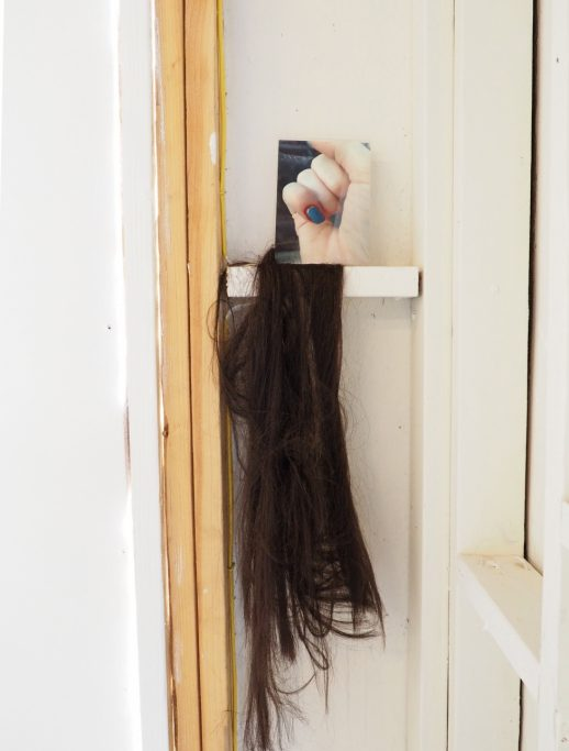 Correspondence (with hair), 2016, photo, plexiglass, synthetic hair, variable dimensions